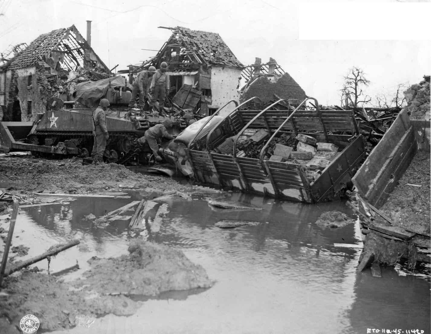 M4 Bulldozer tank and overturned trucks in Merode Germany