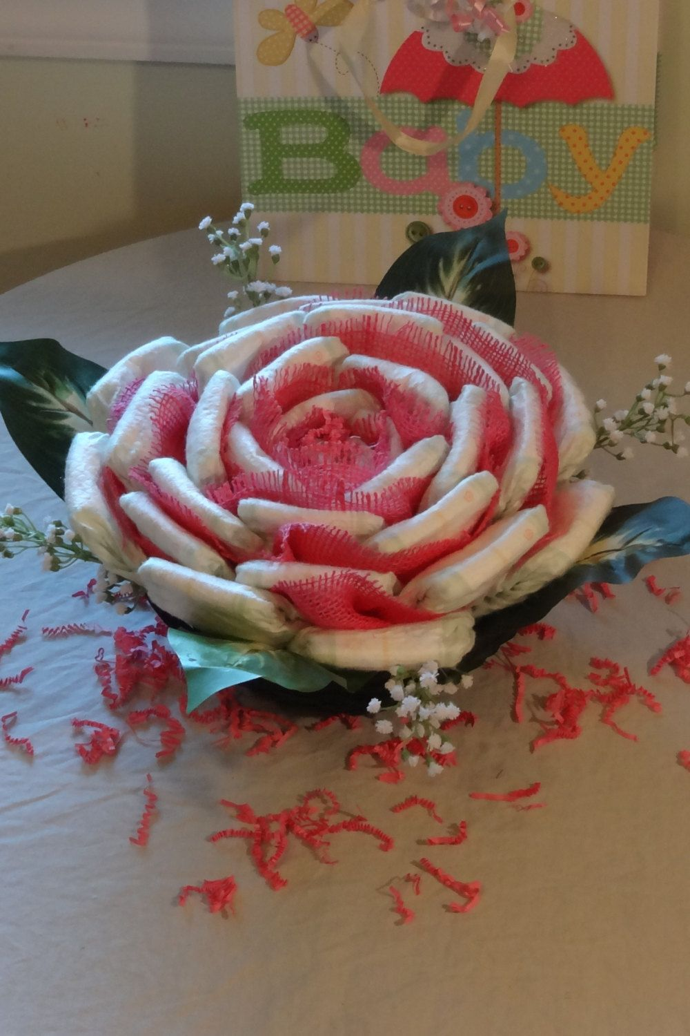 Baby Showers Diaper Cakes ~ Diaper rose basket centerpiece baby shower gift