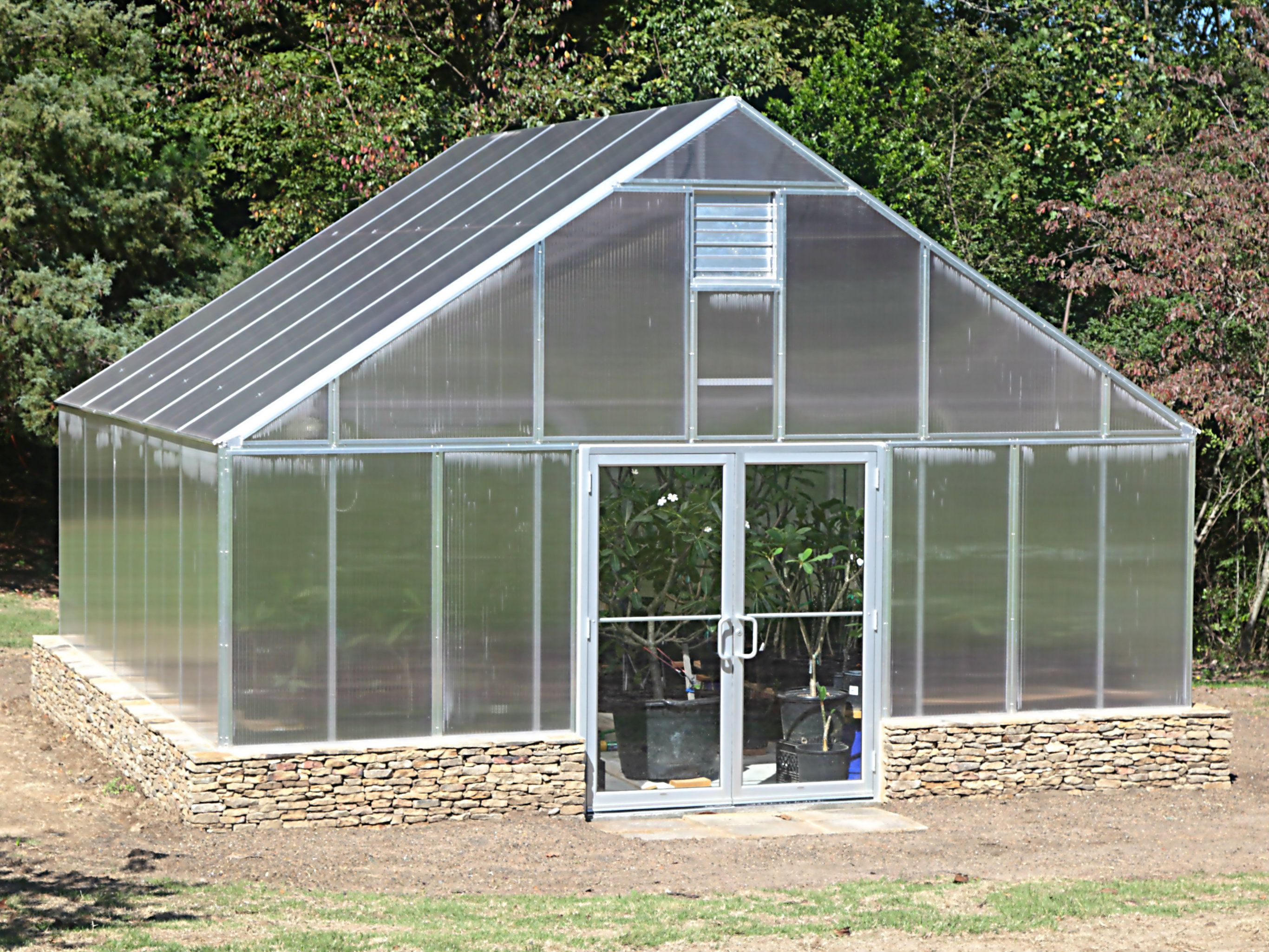 This beautiful 20' x 20' 16mm five-wall polycarbonate greenhouse is on