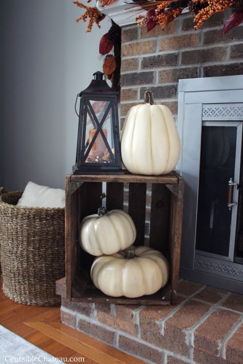 Photo of Lowes Showroom –  The Chic Technique: Fall fireplace display with crate, white p…