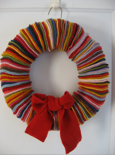wreath made from re-cycled sweaters found at thrift stores!