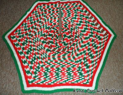 This is a tree skirt that I made for our family room tree years ago ...