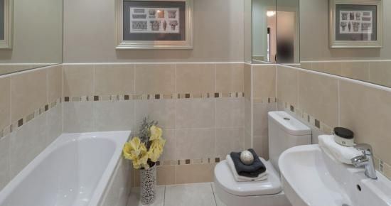 An en-suite bathroom with the latest designer suite and decor. #newhomes  #property
