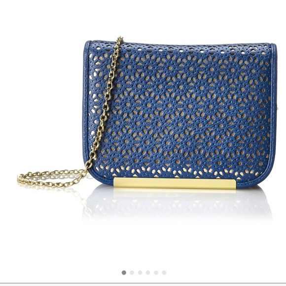 Navy Perforated mini shoulder bag Magnetic snap closure. Chained crossbody strap. Flat base to provide upright structure. Lined interior. Interior slip pocket. (only used once, like new condition) Jessica McClintock Bags Crossbody Bags