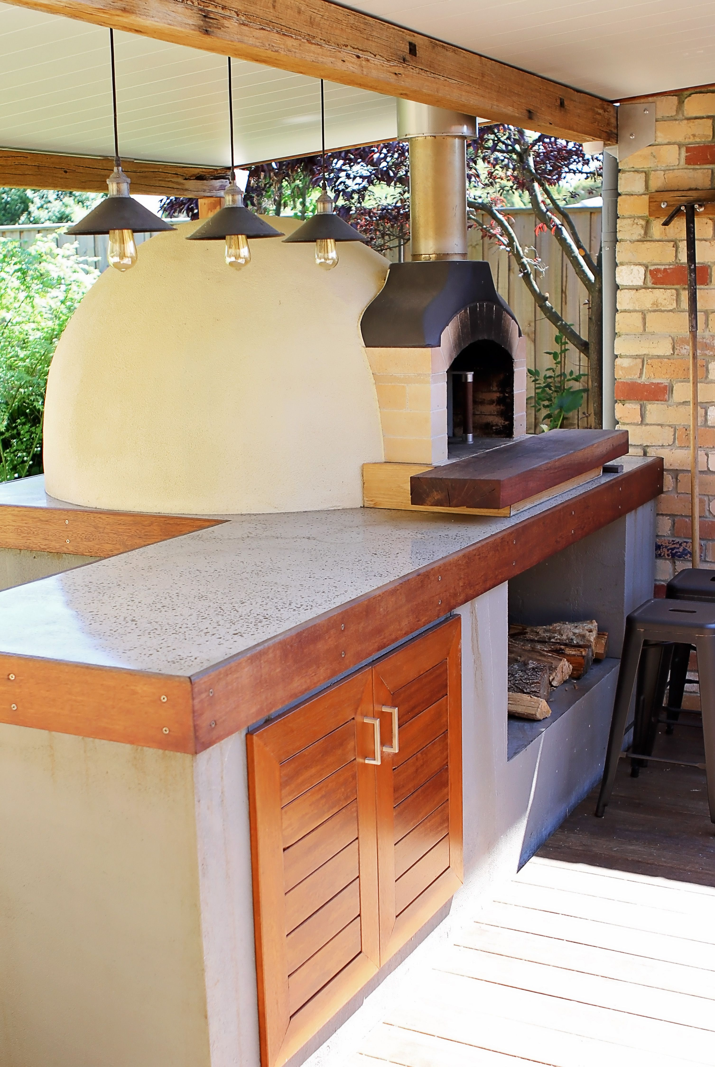 Exposed aggregate polished concrete benchtop with wood