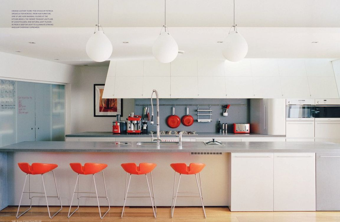This morning I'm loving this crisp kitchen with orange accents from Vogue  Living Australia .
