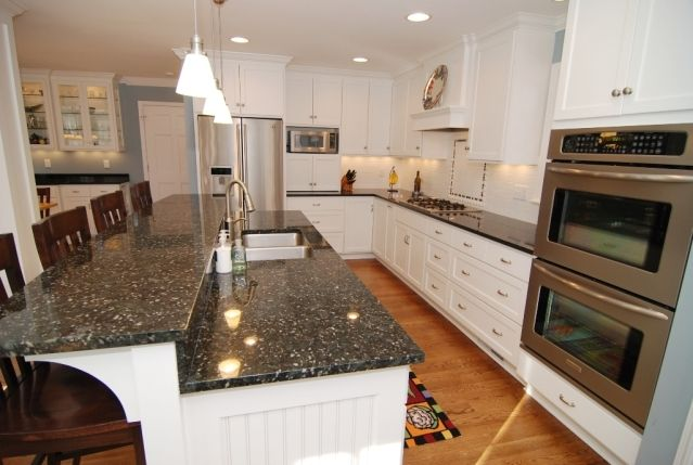 Verde Butterfly Granite Counter Tops With White Cabinets
