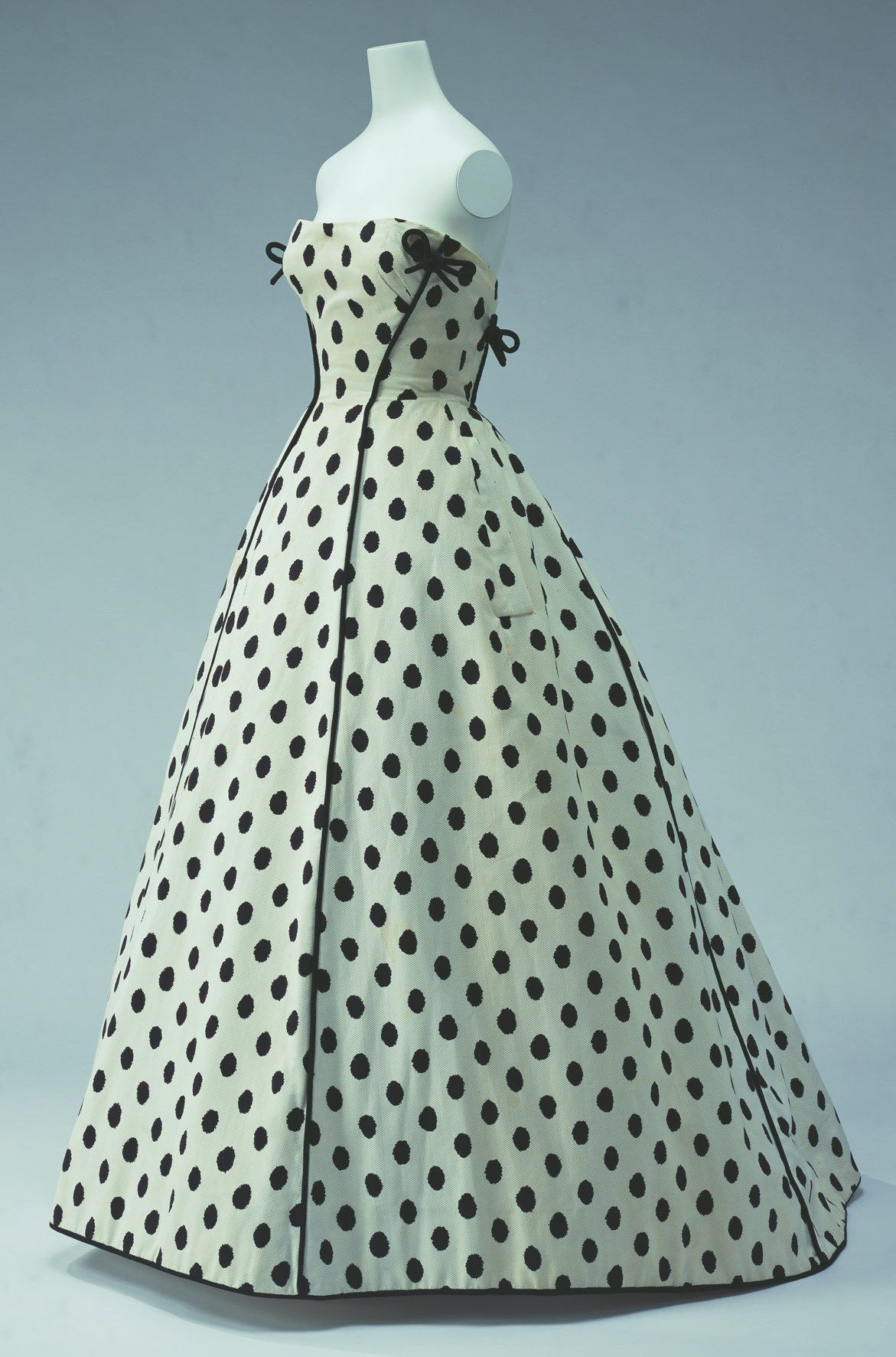 """Evening Dress, Jacques Fath: ca. 1953, printed cotton piqué trimmed with black piping. """"This dress is a typical fashion from the 1950s, which reminds us of the age of crinolines... The elimination of formality in this dress had already the casual feeling of the latter half of the century..."""""""