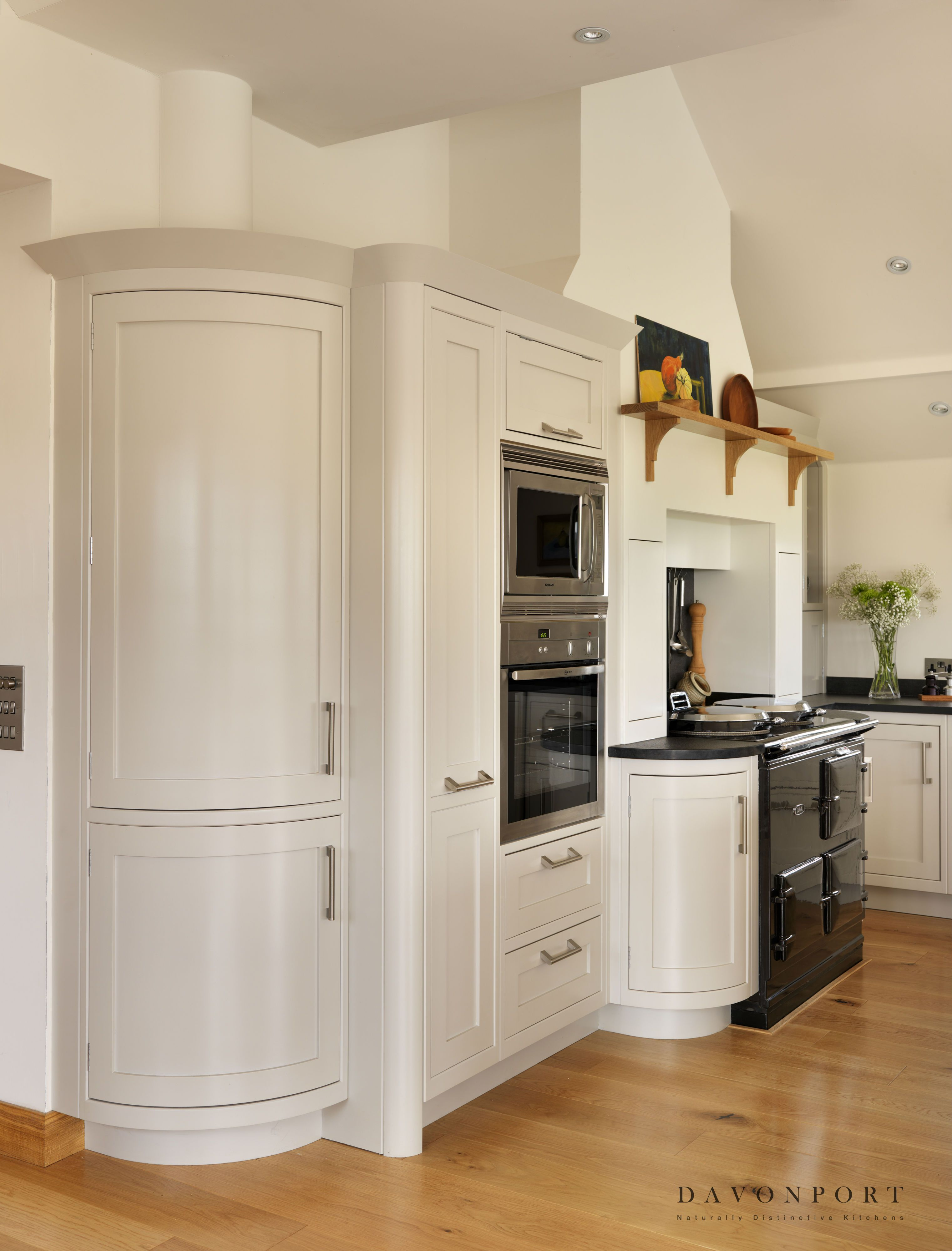 the angles of the room are softened by the curved corner cabinets producing a smooth flowing on kitchen cabinets corner id=38656