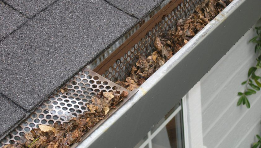Cost Of Gutter Guards Are They Worth It The Money Pit Cleaning Gutters Gutter Cleaning Tool Gutter Guard