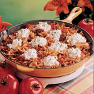 Skillet Bow Tie Lasagna Recipe -- another great dish where you cook the pasta IN the sauce. So much easier than traditional lasagna. =) My kids loved it!