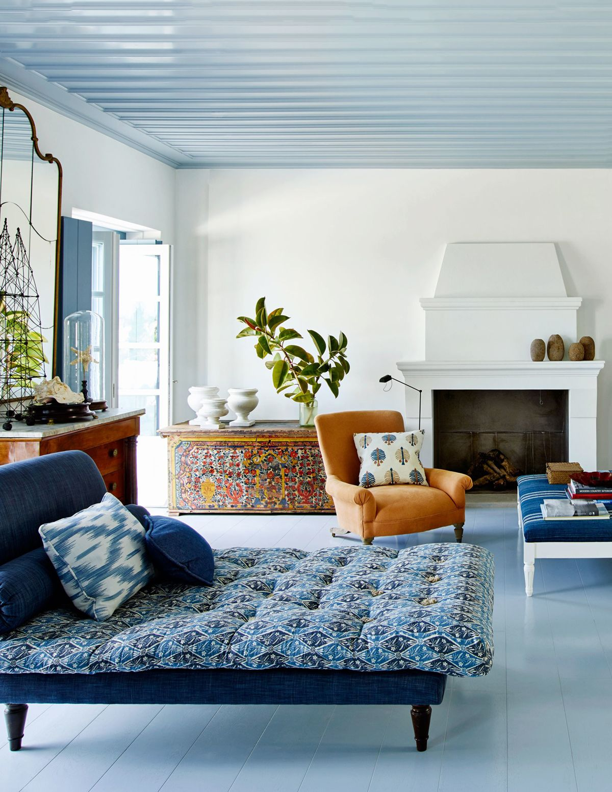 Interior design by isabel lopez quesada greece greek island living room in blue and orange house tour via coco kelley