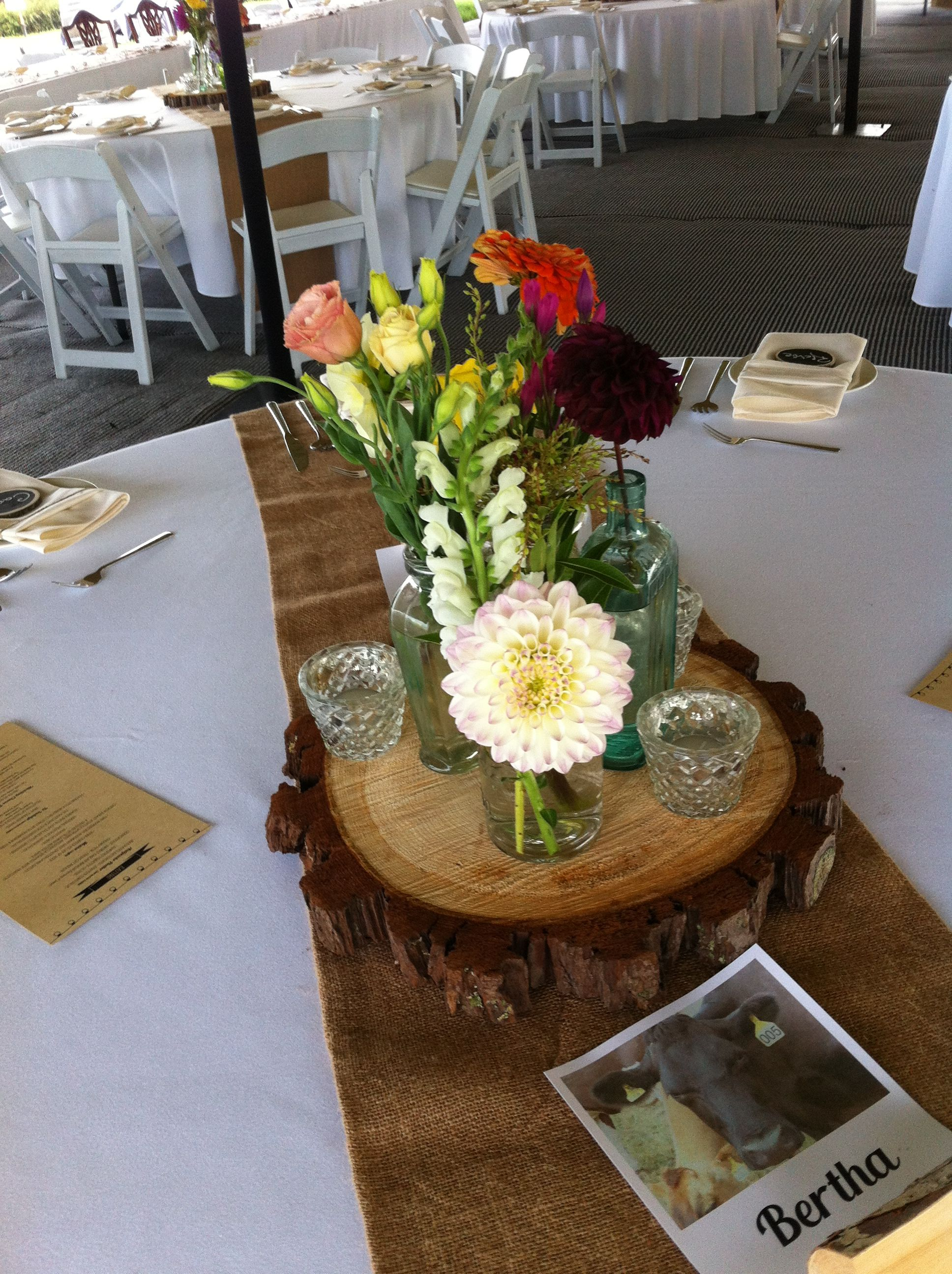 Jars on wooden slab -  Rustic wedding flowers made by Amy's Flowers