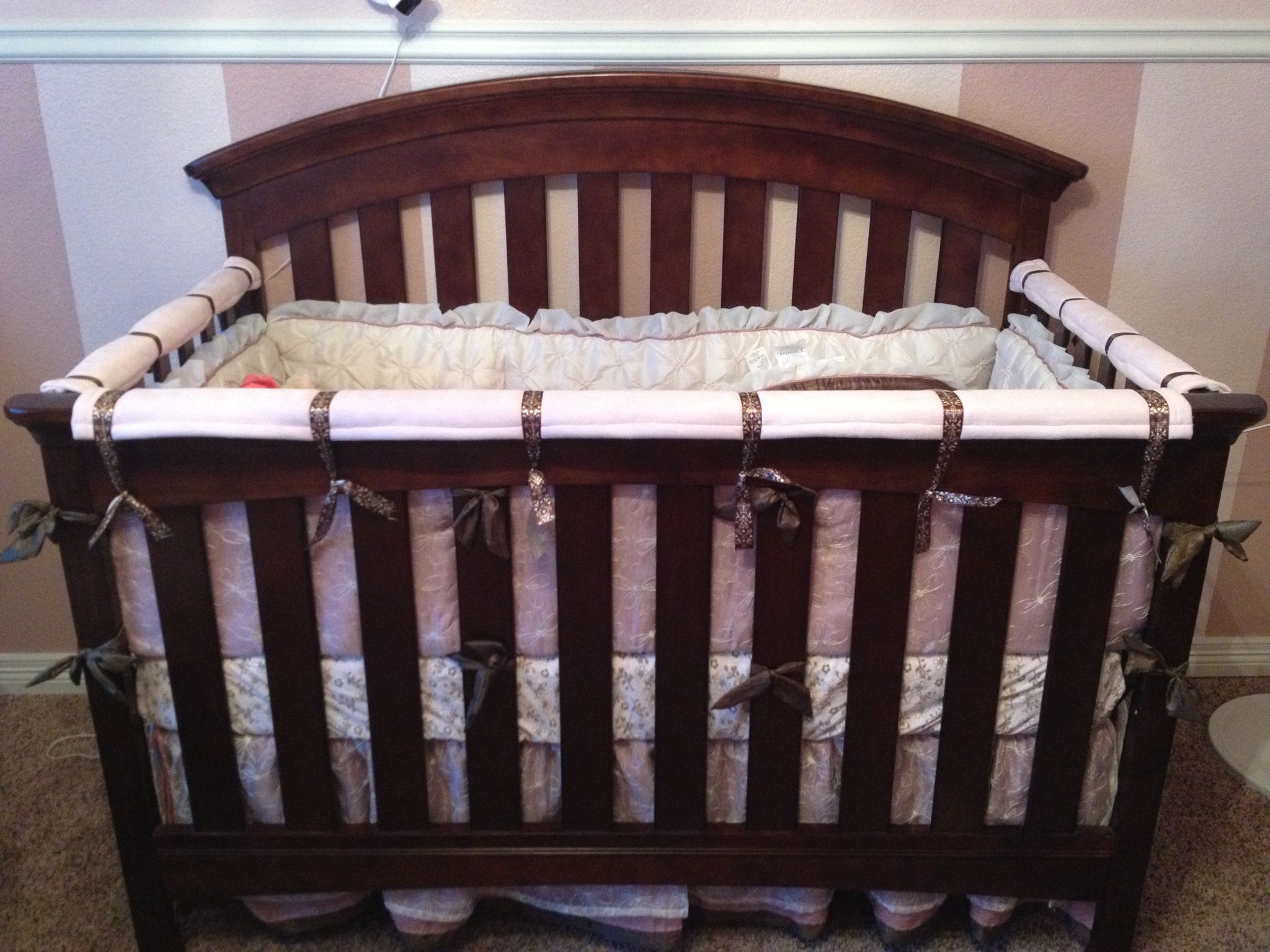 Crib rail covers. Use thick fabric or add quilt battling