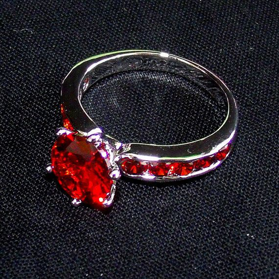 Check out this item in my Etsy shop https://www.etsy.com/listing/220900312/red-garnet-ladies-ring-99-mm-silver-ring