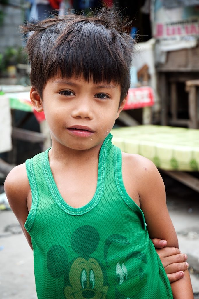 A shy smile from Mel's son— With support from Holt sponsors, the children also receive a nutritious meal every day at daycare — supplementing their diets, and reducing the risk of malnutrition.