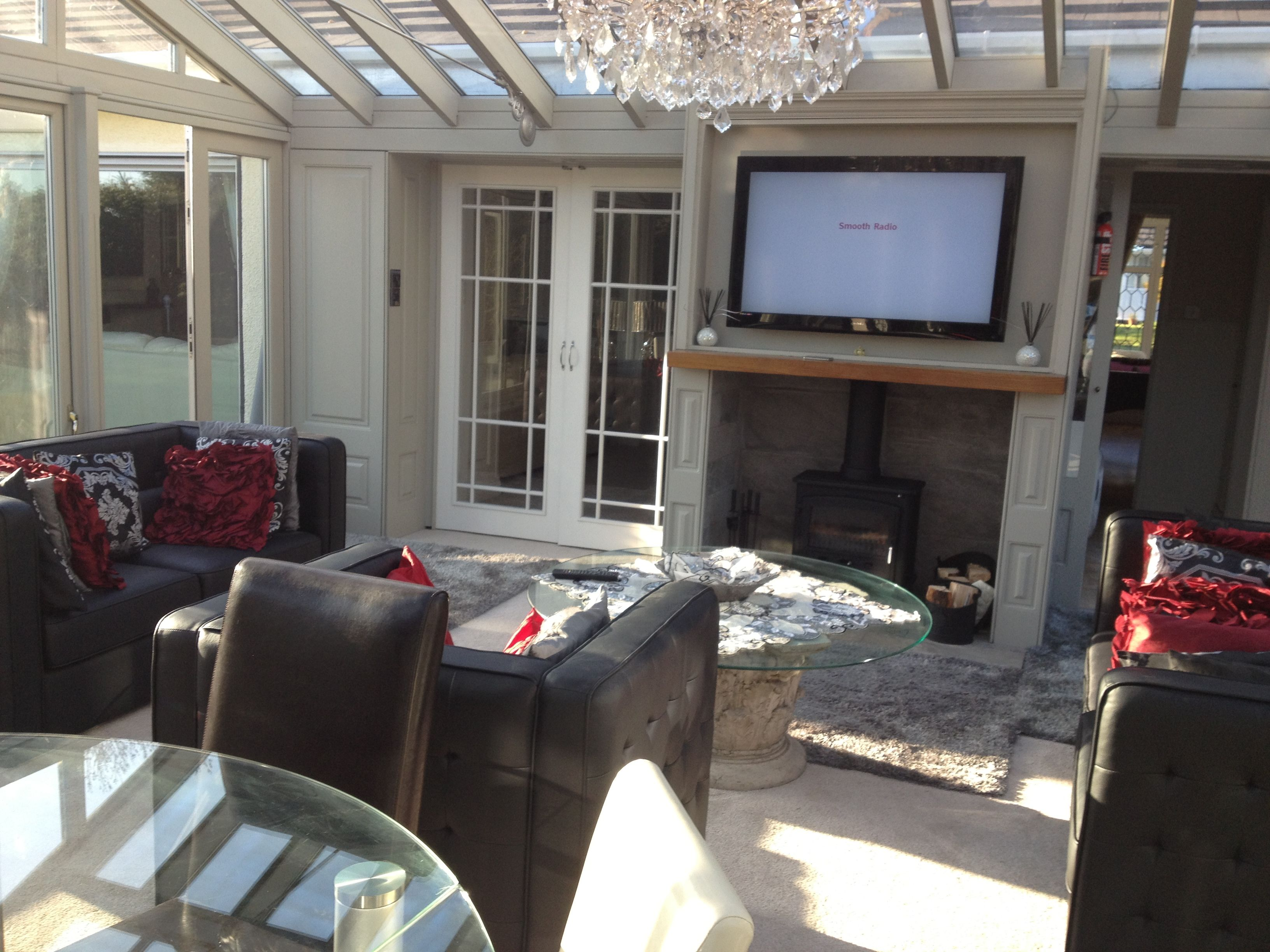 Conservatory Panelling With Specially Designed Fireplace And Tv