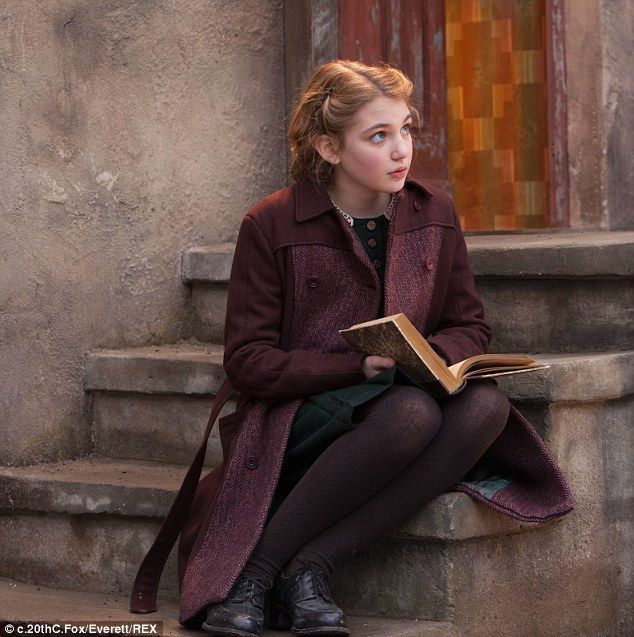Sophie Nelisse and Kathy Bates share a tender embr