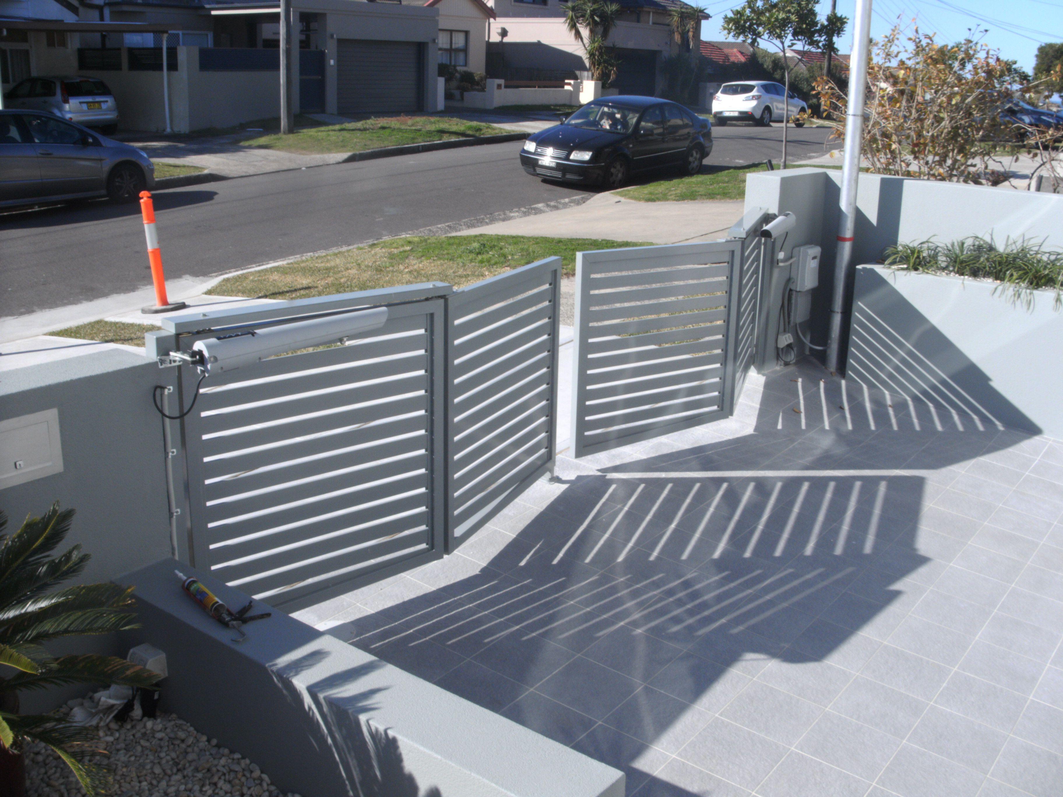 garage door entrance ideas - Low Bi fold gate New Gate Designs Pinterest