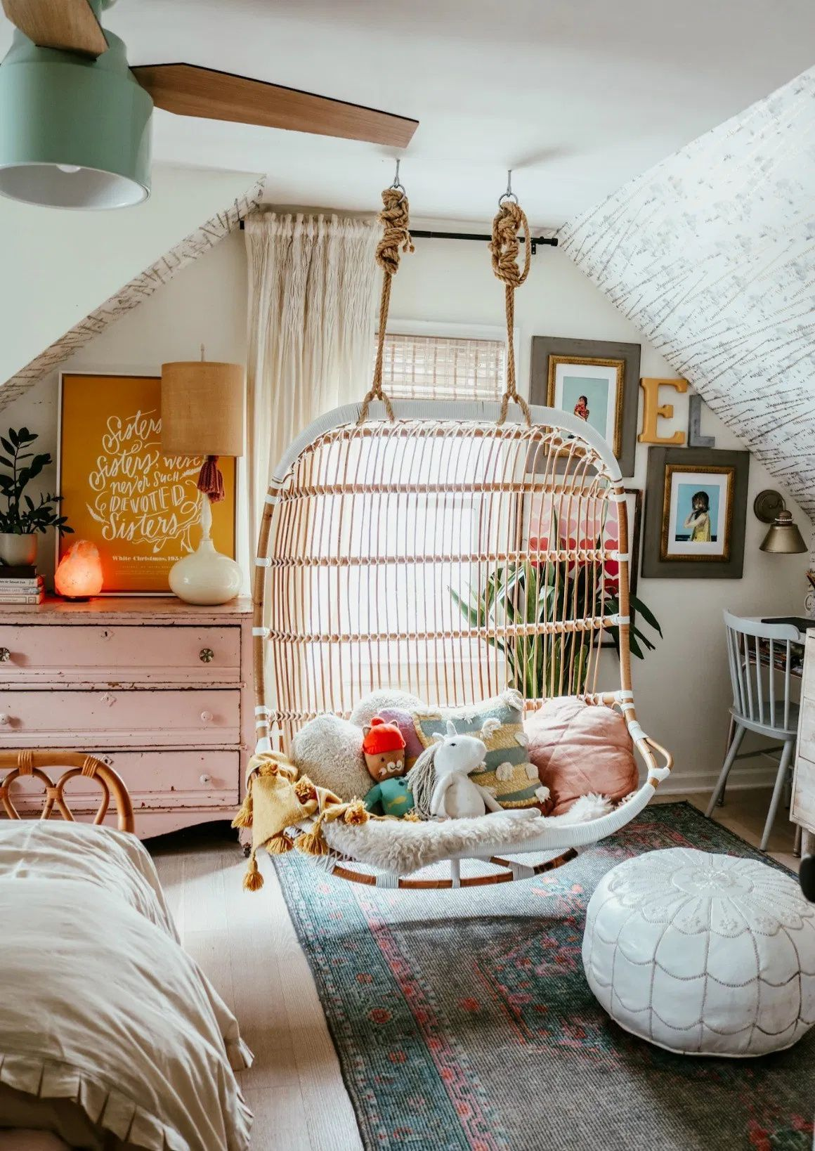Girls Bedding Refresh with New Beds | Nesting With Grace | Boho chic shared girls room with wallpapered walls and rattan twin beds. #girlsroom #bohochic