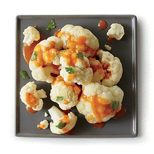 MyRecipes.com || Cauliflower with Coconut Curry Sauce: This low-cal side doesn't skimp on flavor thanks to red curry paste and soy sauce mixed into the coconut milk sauce. || Cooking Light
