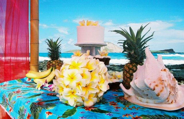 Hawaii cake with pineapples and yellow plumeria bouquet Hawaii