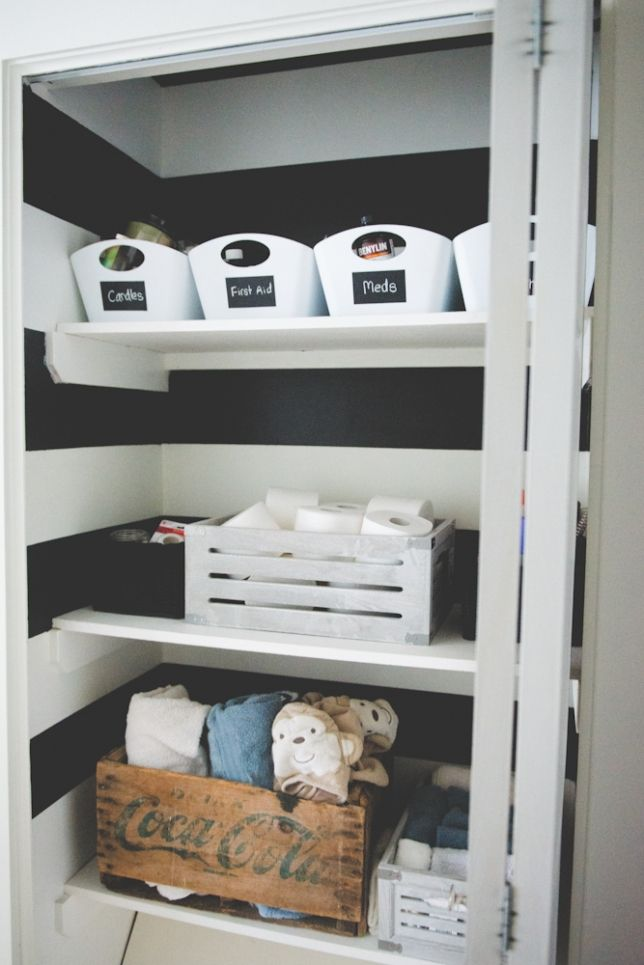 Organized Linen Closet With Black And White Stripes Painted. Before And  After On The Blog