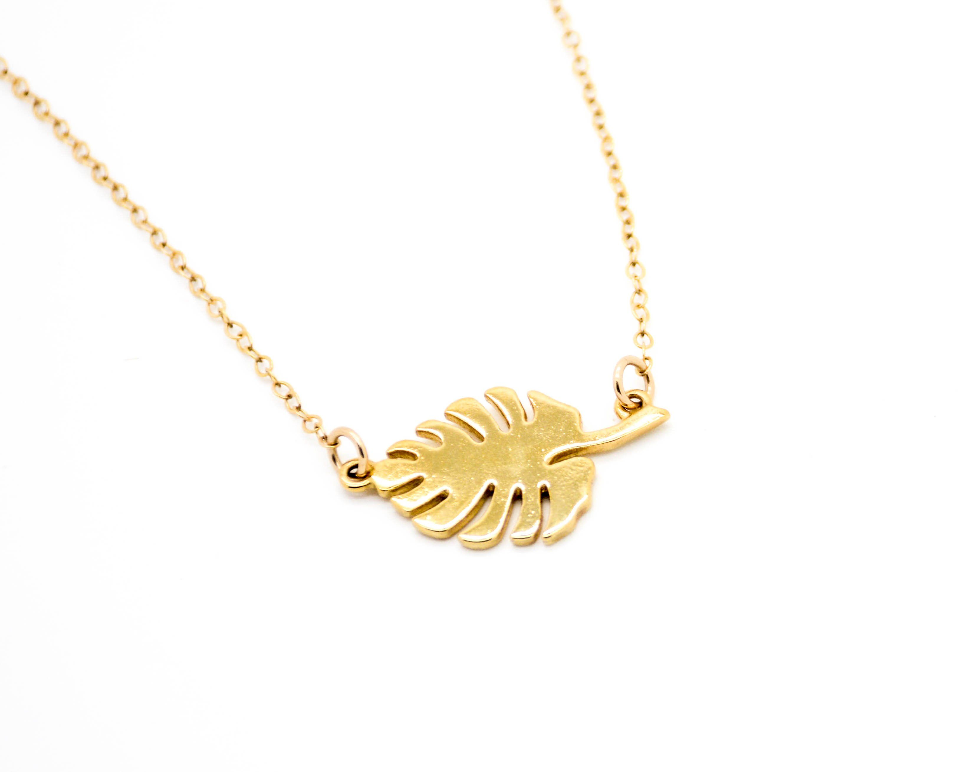 """A beautiful Monstera Leaf hanging on a delicate 16"""" cable chain. Pendant is 1"""" in width, cast with brass and plated with a beautiful 14k gold plating to last. This is a statement piec..."""