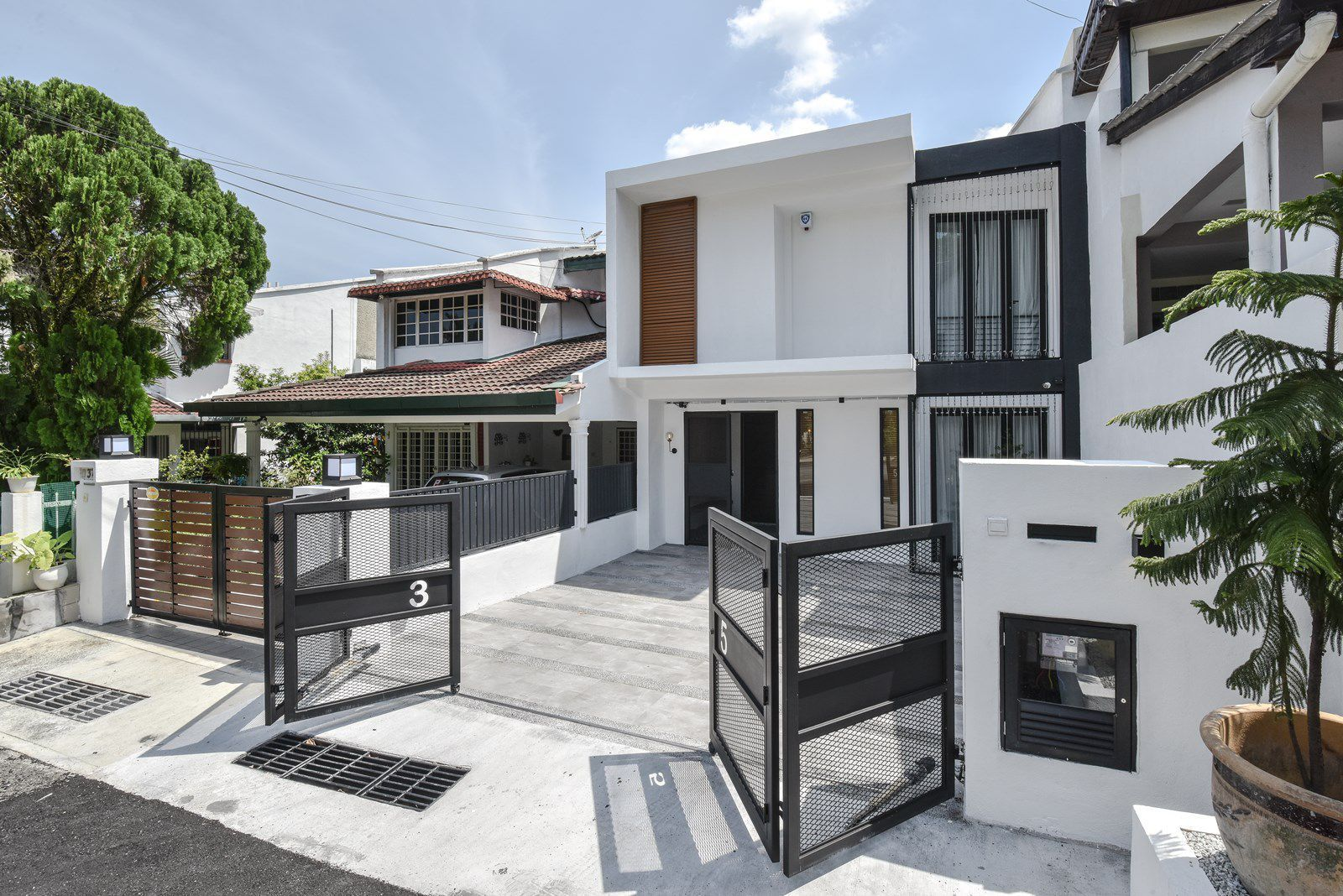Modern terrace house exterior stands apart from its more - Interior and exterior home design ...