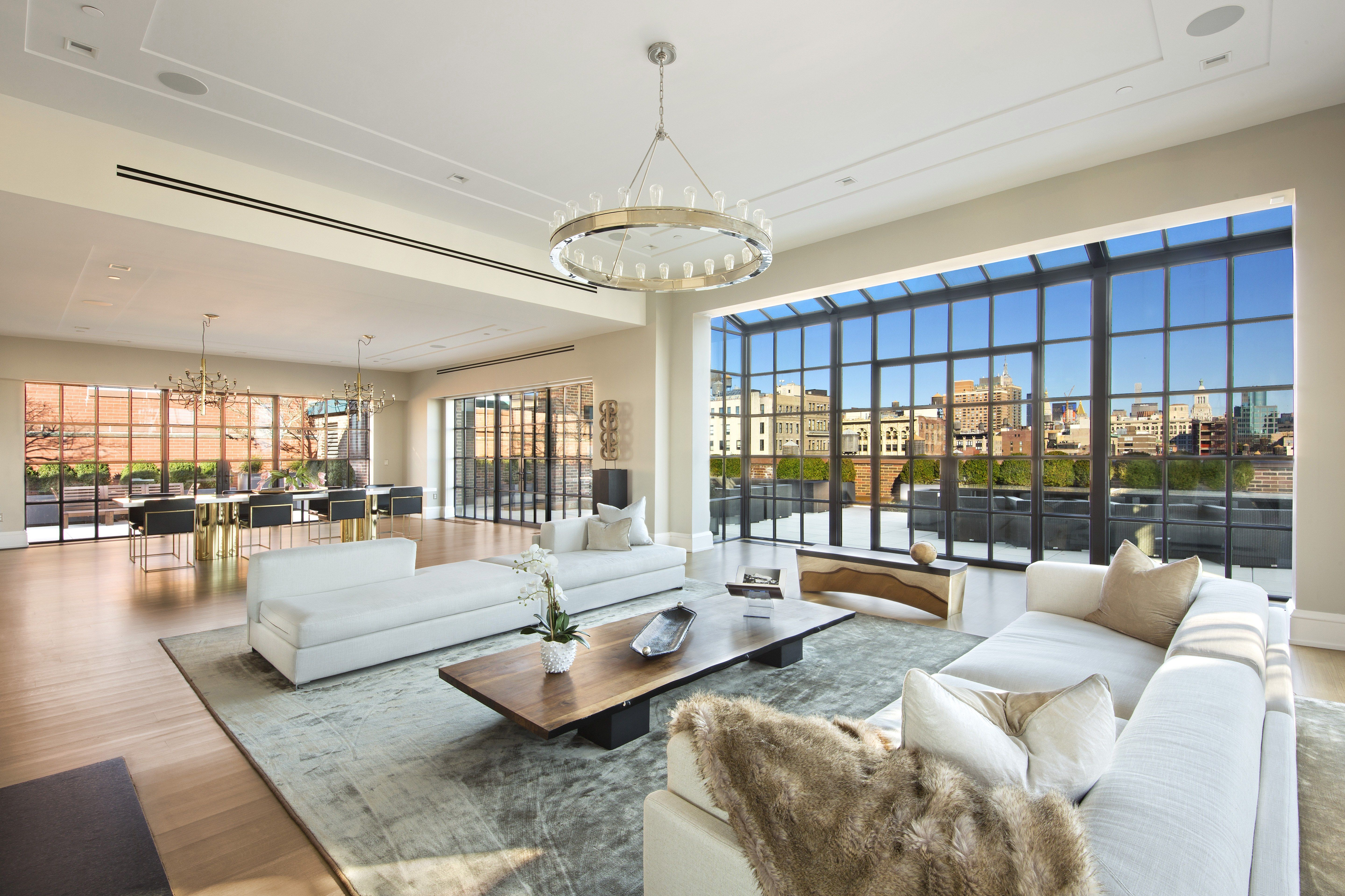 Floor To Ceilings Windows Offer Incredible Manhattan Views In The Great Room
