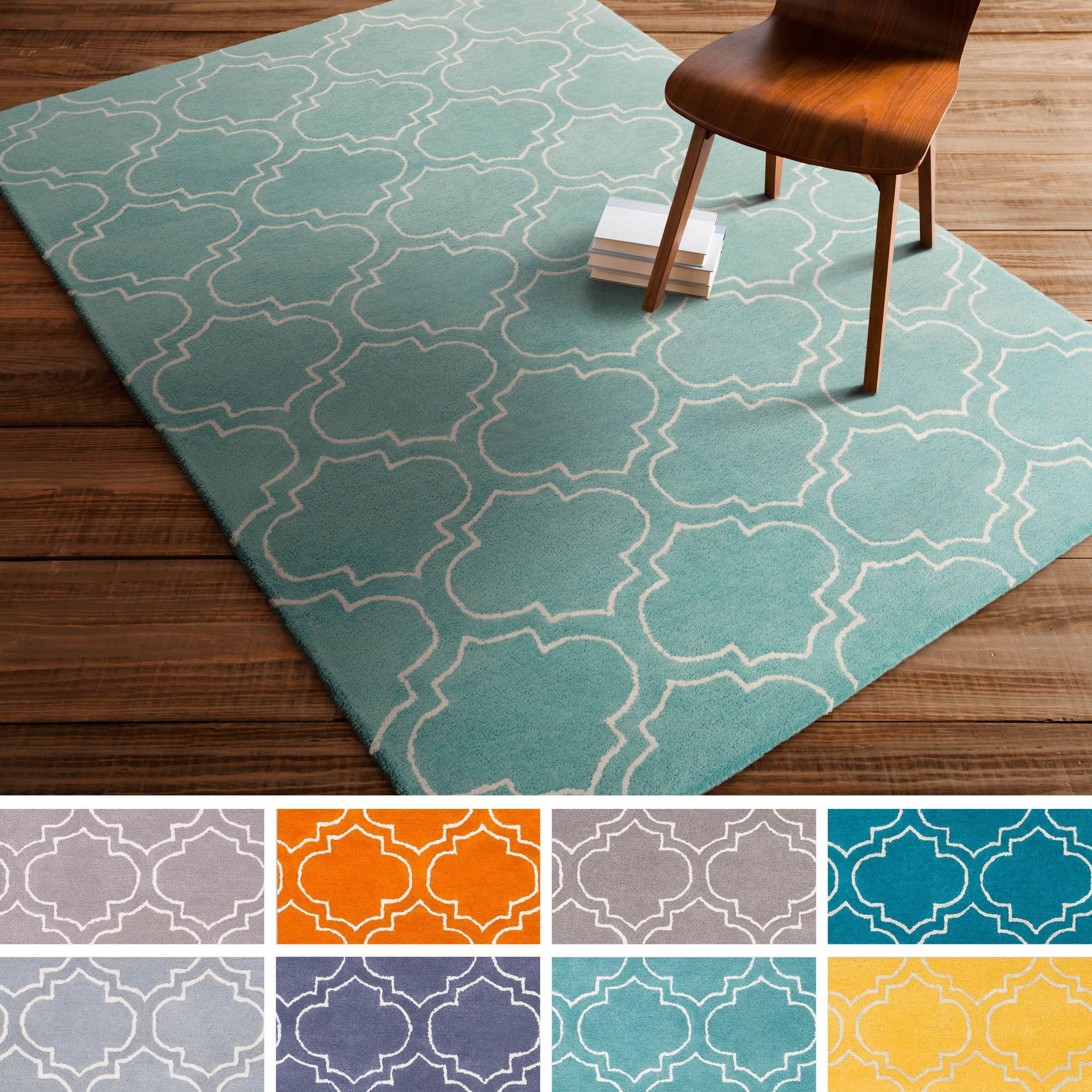 Bring luxury to your home with this contemporary area rug. Hand ...