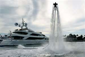 Propelled through the air on a stream of water. jet lev