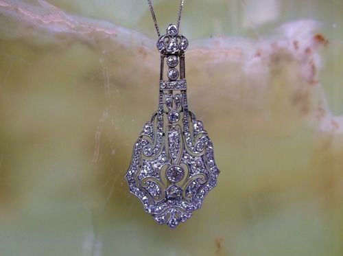 """SOLD - Exquisite Art Deco diamond and platinum pendant with 2.70 carats total weight in Old European cut and single cut diamonds. (Approximately 2.0"""" in length.)"""