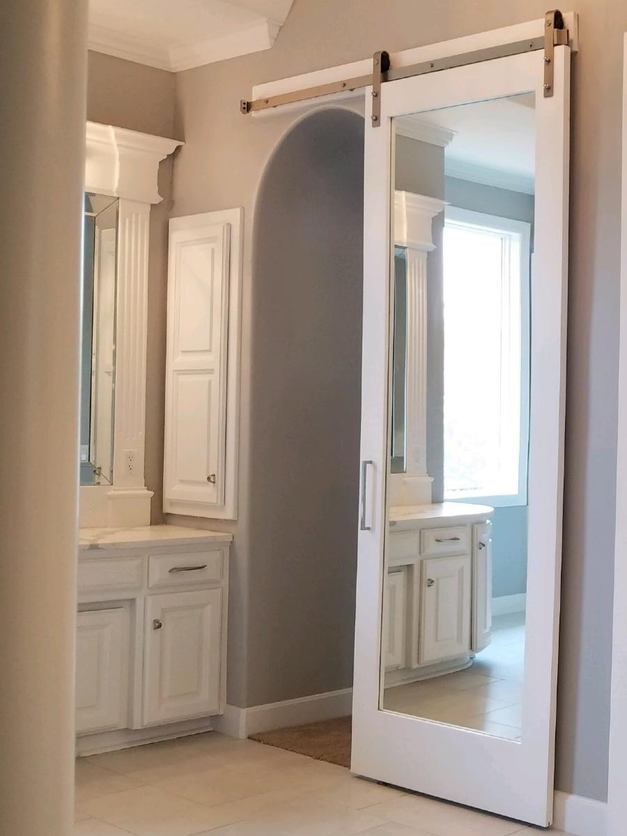 Mirror Barn Door Walston Door Company North Kansas City Mo In 2020 Mirror Barn Door Making Barn Doors Interior Sliding Barn Doors