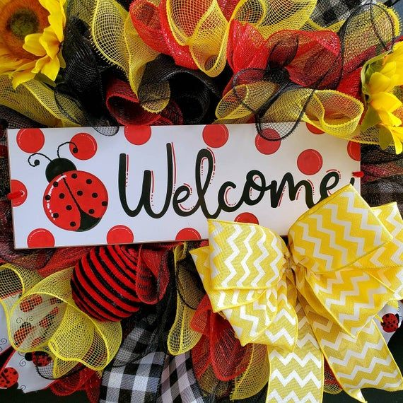 Photo of Pretty lady bug sunflower wreath for spring and summer. Welcome wreath. Red and black decoration yellow me