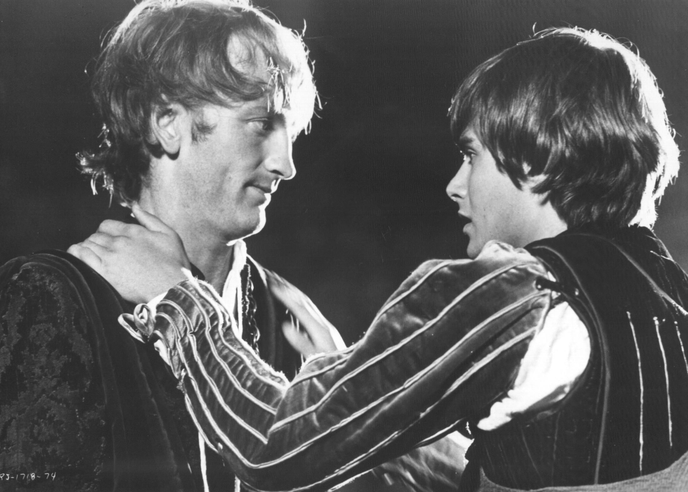 Compare the effectiveness of the Romeo and Juliet street fight scene in the movies...Zeffirelli(1968) and Luhrmann(1996)?