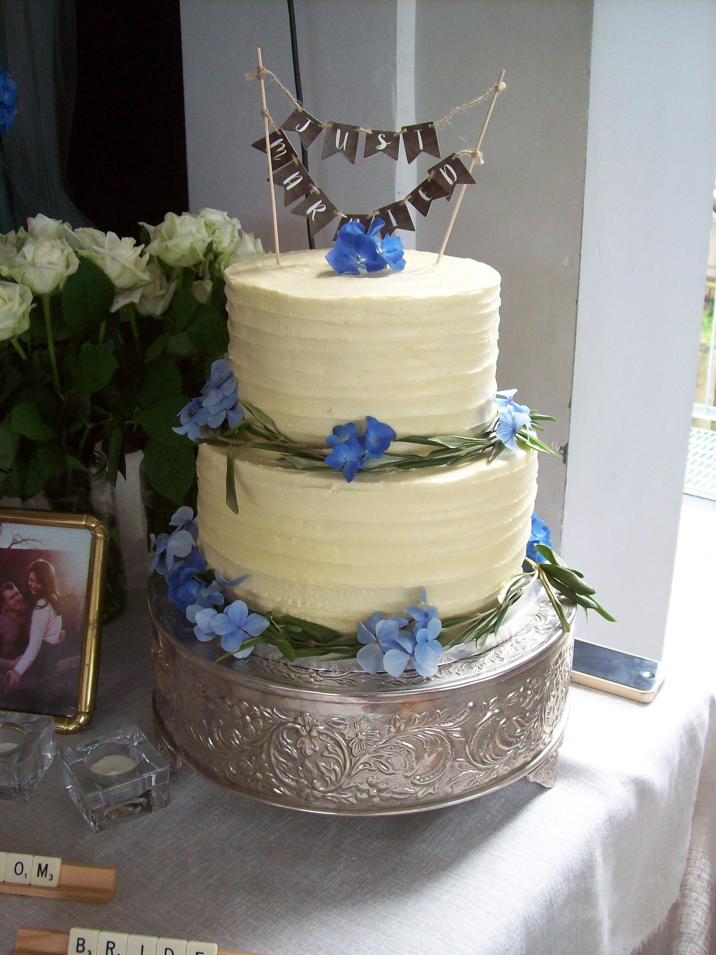 Buttercream wedding cake 395 topper and adornments added