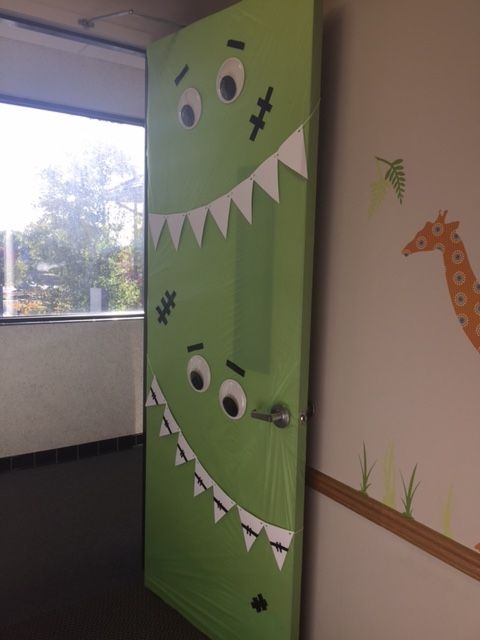 Monster door for Halloween. We always decorate our door but this is the one that started it all! www.briargatepediatricdentistry.com