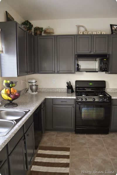 Black Appliances And White Or Gray Cabinets How To Make It Work - Dark grey painted kitchen cabinets