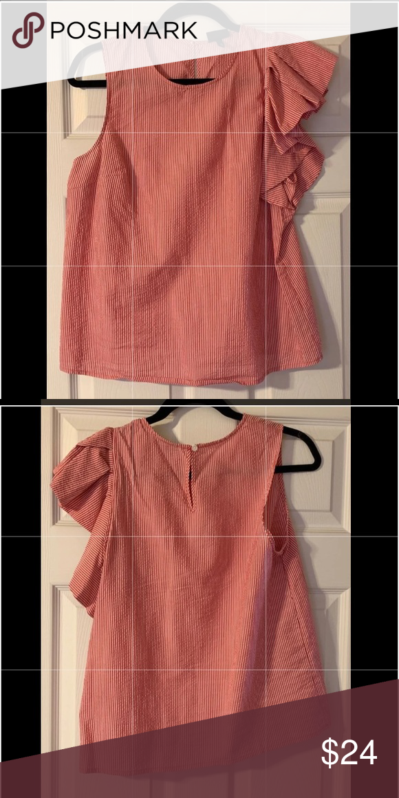 342ba524fc3f4b Sleeveless ruffle top Red/white sleeveless top. Ruffle on left side. Worn  once