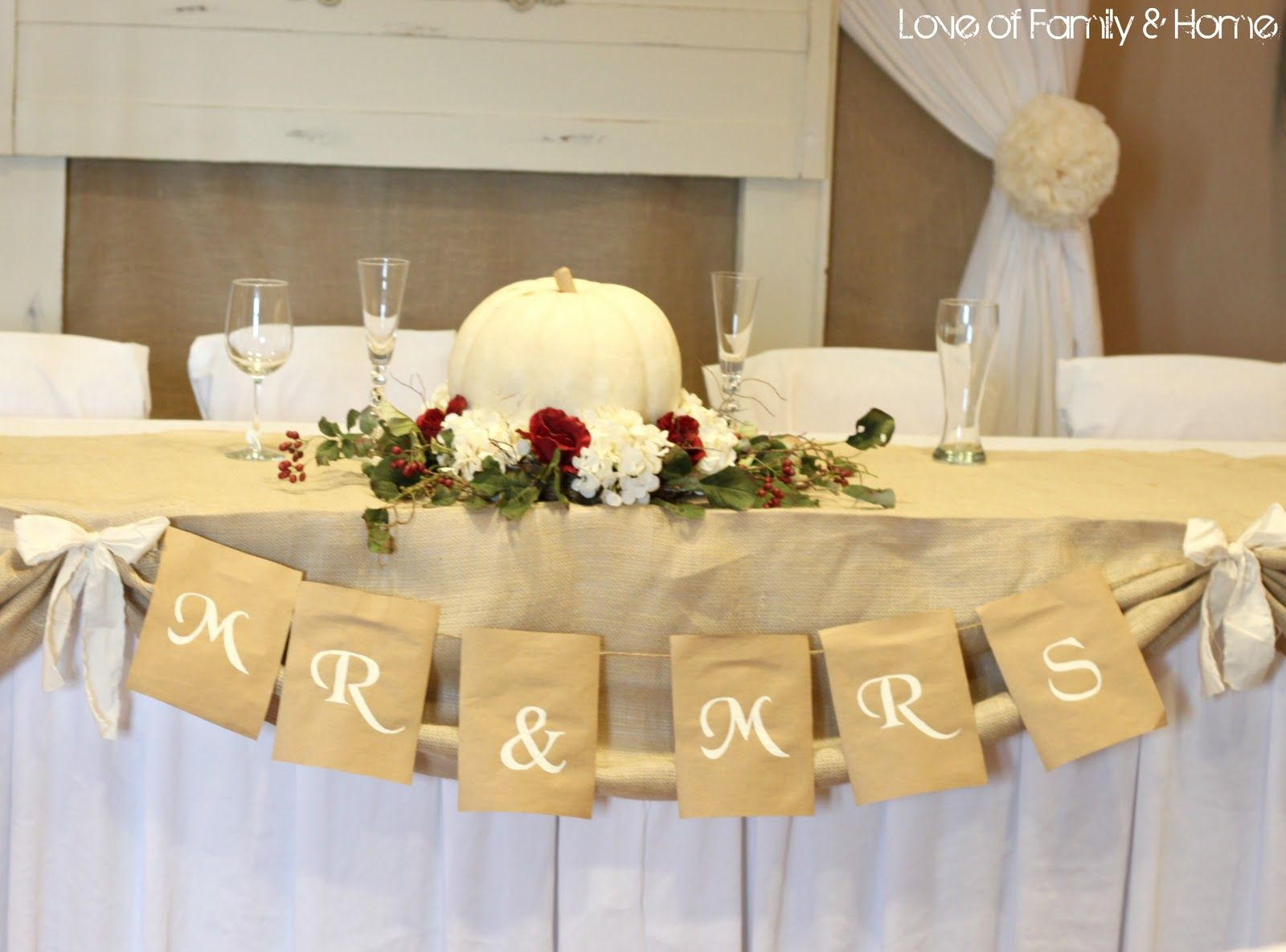 Home wedding decor ideas  Sign for head table not in burlap in black white yellow roses on