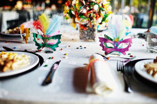 Wedding favors decorated with colorful carnival masks