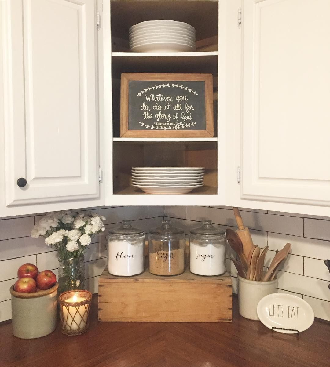 Farmhouse kitchen with butcher block countertops and subway tile
