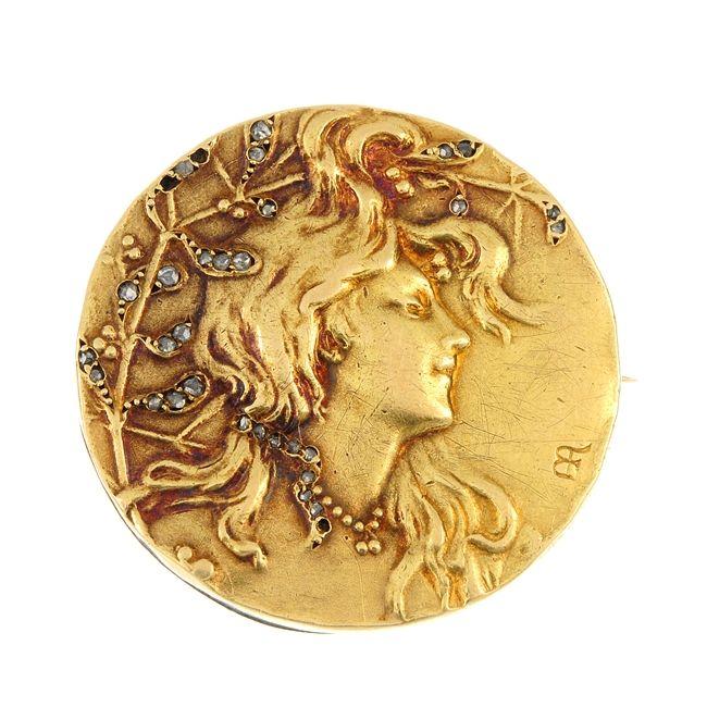 A French Art Nouveau 18ct gold diamond medallist brooch.