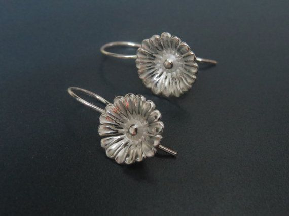Check out this item in my Etsy shop https://www.etsy.com/listing/209670380/sterling-silver-flower-earrings-classic