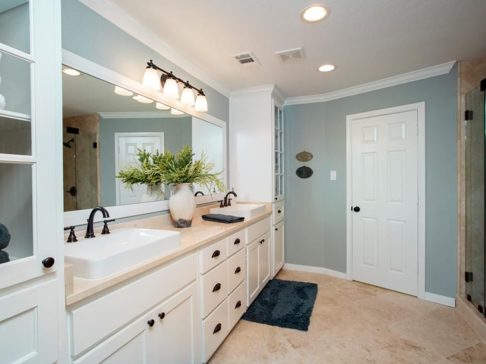 Fixer Upper 39 S Best Bathroom Flips Calming Colors Glass Front Cabinets And Blue Gray Walls