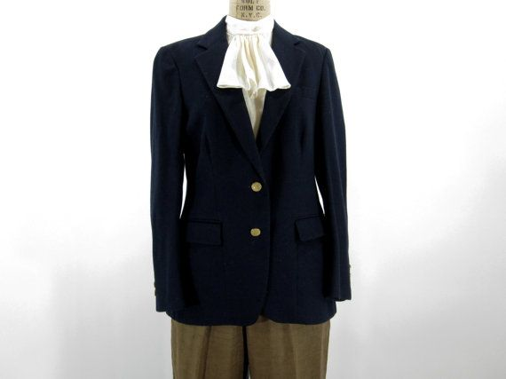 Vintage blazer in a navy blue wool or wool blend, with gold metal nautical buttons. Darted bodice, two button closure, and two flap pockets at hip.    Made by Anthony Allan for Donnelly's. Dry clean only. Labeled as a size 10, and will fit a women's size medium.  $34.00