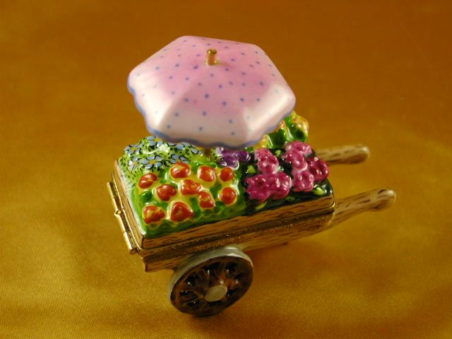 http://www.limogesfactory.com/limoges-boxes-and-figurines/flower-cart-P4702.html Flower cart