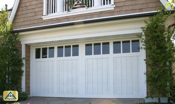 Can Be Custom Painted Stained Has That Subtle Farmouse Door Look While Still Being Able To Transition To Carriage House Doors Custom Garage Doors House Doors