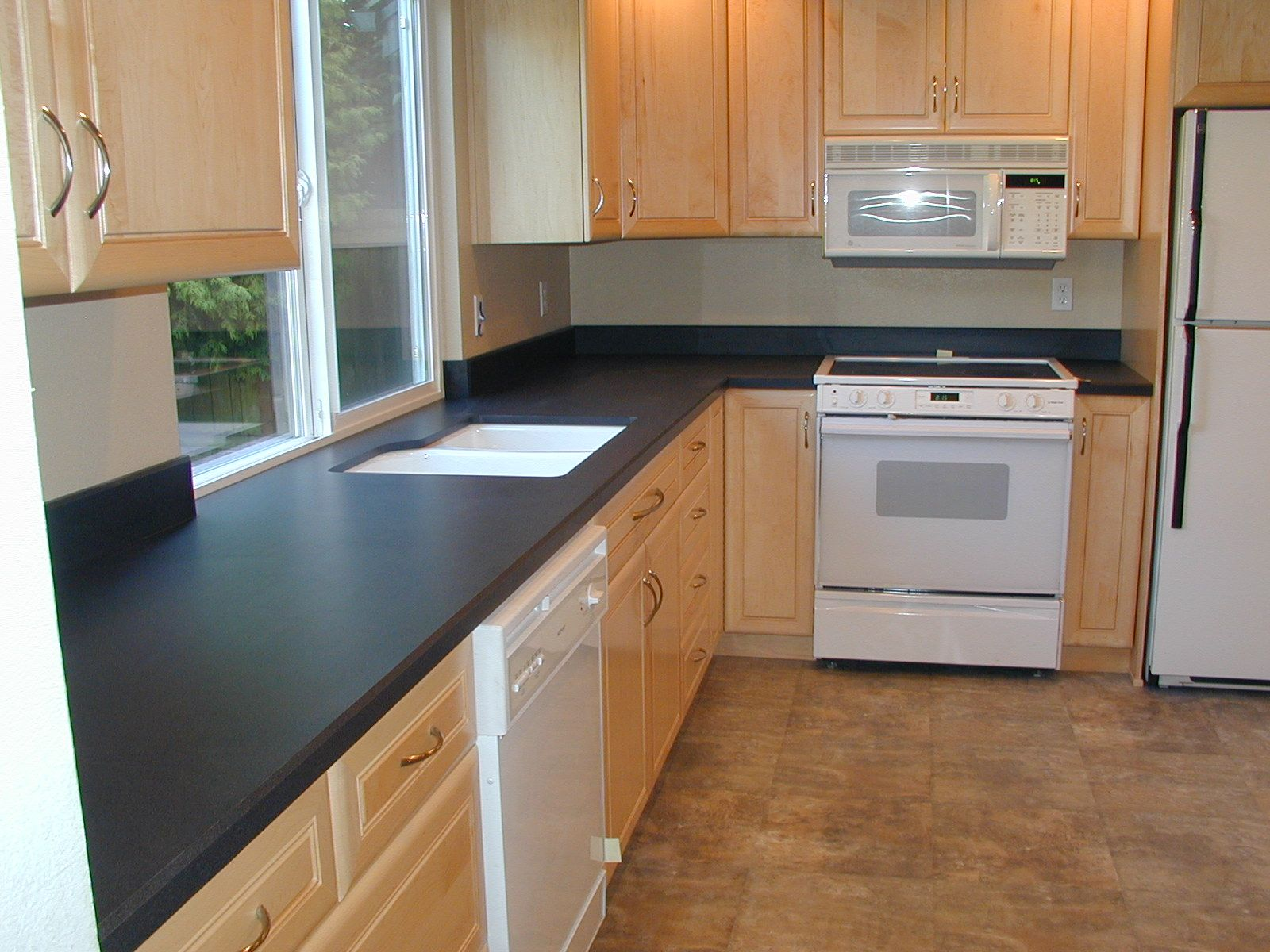 Kitchen Ideas With Dark Countertops | Countertop Design And Installation,  Laminate Kitchen Countertop .